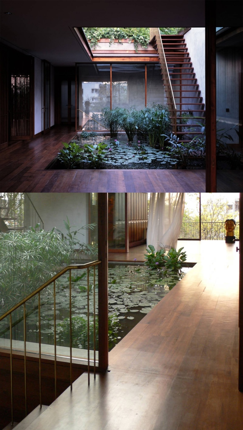 Openair internal water garden surrounded by smooth wood for Indoor pond design