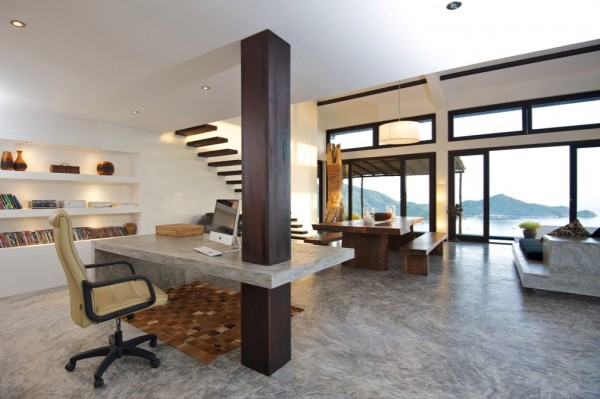 Tropical Beach Villa- dark wood framed open plan living and workspace with distant ocean views