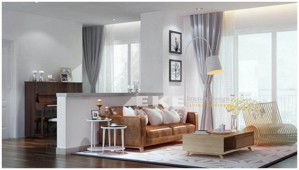 Tuananh Eke's white living area with half height partition and vintage look leather couch