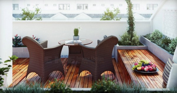 Tuananh Eke's wooden terrace with chocolate outdoor furniture and still life fruit accessorizing