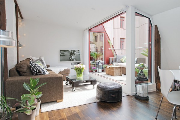 b Urban Apartment with Terrrace- white living with exposed beams and view to terrace