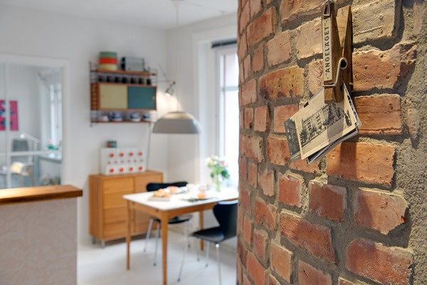 j Urban Apartment with Terrrace- brick wall thoroughfare with view to casual kitchen dining