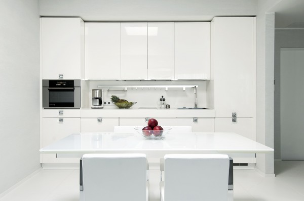 kitchen high gloss white with modern dining setting and minimal accessorizing