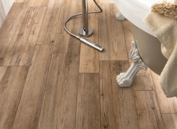 medium rough wooden floor tiles in bathroom closeup