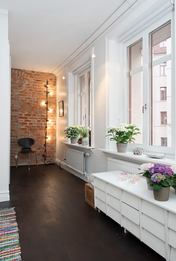 p Urban Apartment with Terrrace- white bedroom with hardwood flooring and exposed brick wall nook