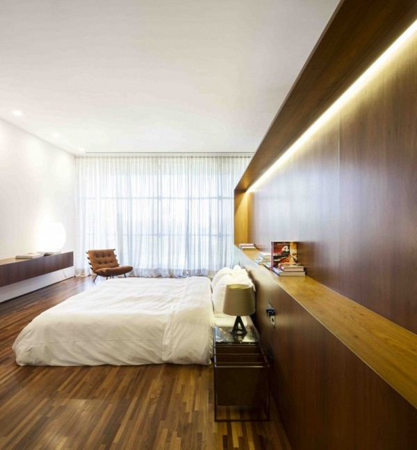 Marcio Kogan's Casa Lee Concrete House- bedroom with wood cladding and flooring