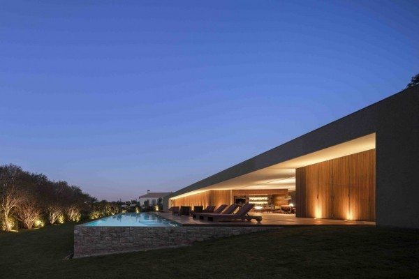 Marcio Kogan's Casa Lee Concrete House- exterior with view of pool and indoor outdoor living