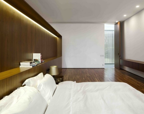 A minimalist approach in the bedrooms allows the angular nature of the space and the richness of the wood to shine, which is of course, aided by recessed fluorescent lighting above the bed, making for optimum night time reading in the happy absence of a television. Square down lighting is preferred to the usual circular look, which also plays on the greater aesthetic.