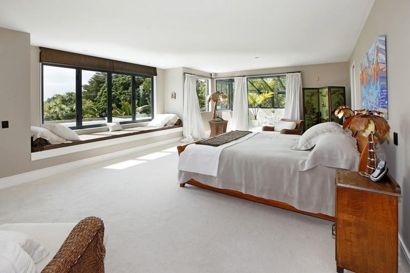 Sotheby s auckland house expansive master bedroom with views from window seat interior design - Expansive large glass windows living room pros cons ...