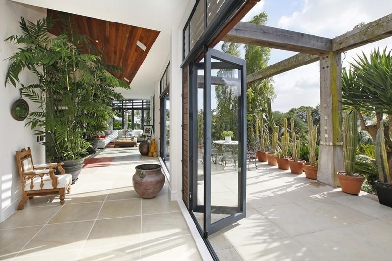 Sotheby s auckland house indoor outdoor living through Indoor outdoor interior design
