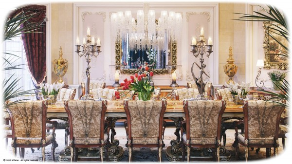 The Villa's main dining room boasts an ornately carved and finished dining table surrounded by 12 plushly upholstered dining chairs covered in velvet.