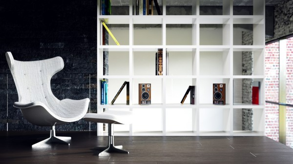 An unique version of Arne Jacobsen's iconic Egg Chair and Ottoman take center stage next to a grid-designed bookcase.