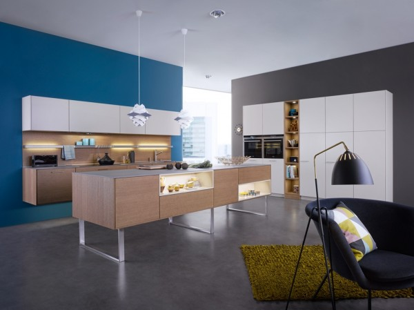 white and blonde wood kitchen blue feature wall