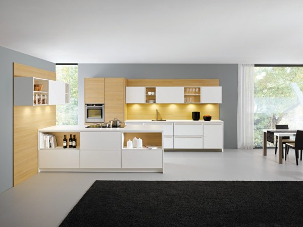 white kitchen units with wooden cladding