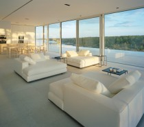 The interior living spaces boast furnishings in pristine white effecting an ethereal palette that bounces sunlight around the room.