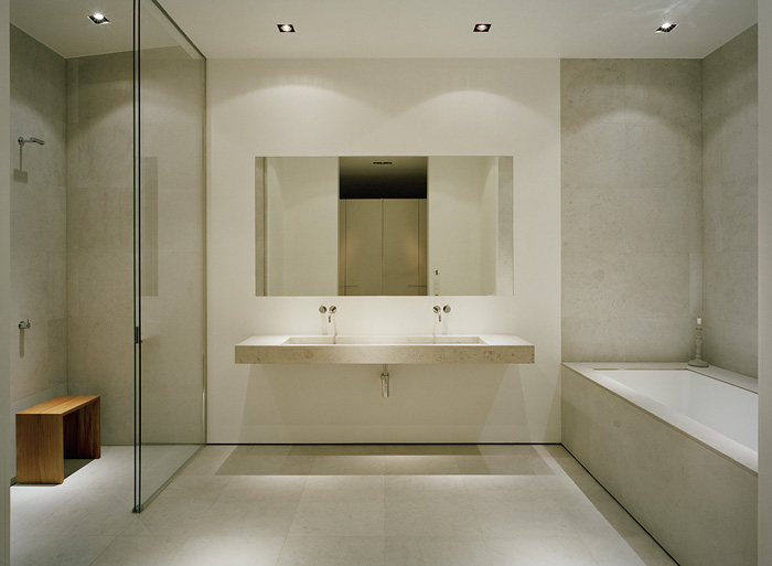The master bathroom is a testament to the beauty of minimalist design with texture and light leading its decor.