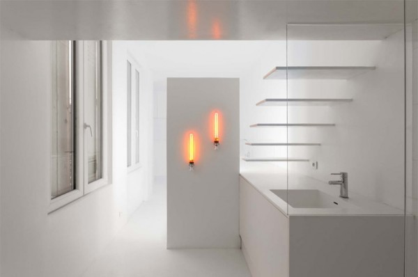 Two low pressure sodium lamps with zero CRI emit warm light in the bath's vanity area.