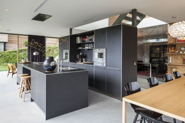The villa kitchen boast sleek modern grey cabinetry and black counter tops. While it is compact, the kitchen still allows for plenty of room to cook while visiting with company or family.