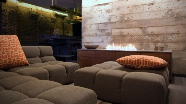 The eco-smart fireplace replaces the bulky standard fireplace on an opposite wall. It burns clean with denatured alcohol with zero carbon emissions and no messy ash and soot. The cool concrete wall was discovered under layers of sheet rock.
