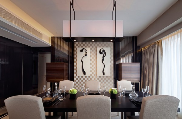 Asian influences give this handsome dining room an exotic repose with artisan crafted screen, lively artwork and dramatic lighting.