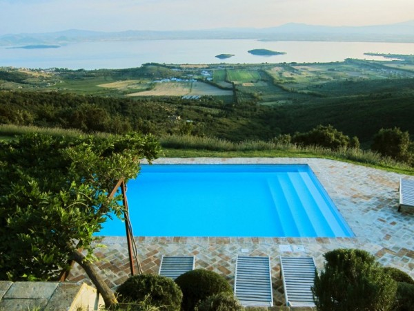 The house also features a pool heated by solar panels. Dug into the mountainside, it features a fantastic view of Lake Trasimeno while almost invisible from the terrace of the house.