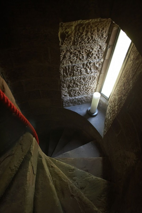 The tower's original stairwell captures the darkside of the tower not seen in its other contemporary additions.