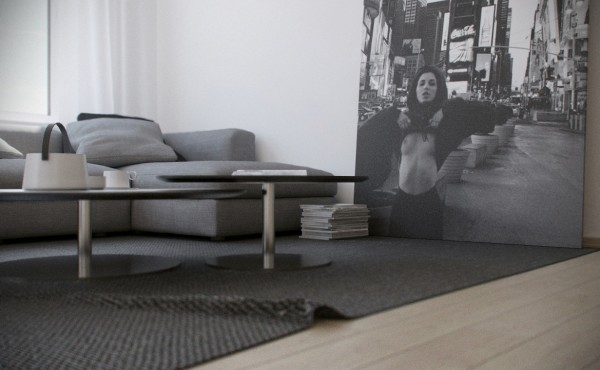 A bold-themed black and white photograph on a grand scale is the focal point of the apartment's living area.