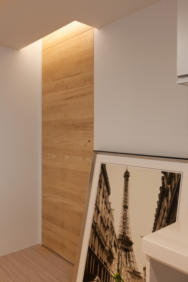 Finally, the lighting in the space is such that the apartment feels warm and welcoming even in the dead of night. Recessed lighting is built into the walls and ceiling rather than relying on lamps and light fixtures. This choice integrates with the apartment's clean lines and reduces clutter.