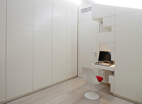 A small built-in desk makes a perfect mini-office in the master bedroom.