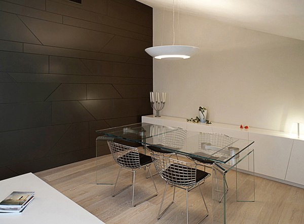 An additional dining area off the living room features wire mesh chairs and a acrylic table.