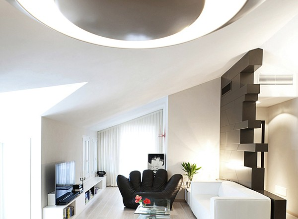 The sharply angled ceiling and angled walls of the living room offer striking architectural elements.