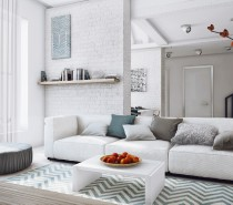 This space, like the previous bachelor's apartment, is all about neutrals paired with textures. This apartment uses a much softer neutral palette, with plenty of light teals, grays, white, and pops of warmer tones, as seen in the living space above. Textures abound through the use of a variety of fabrics and the chevron rug is a look that is both striking and simple.
