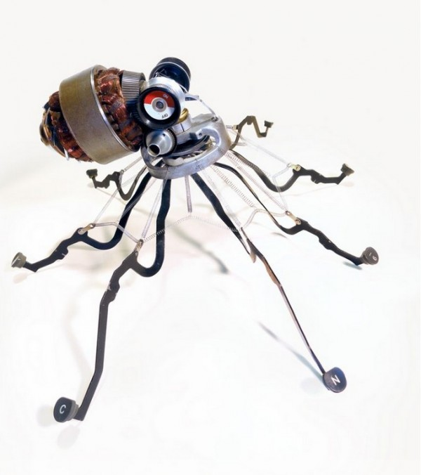 Among his many animal sculptures an octopus emerges from a myriad of typewriter parts including the keys he uses as legs.