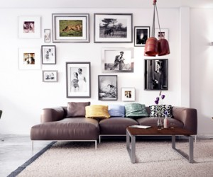 A gallery art wall adds height above a low-profile sofa taking the eye upward toward the soaring ceiling.