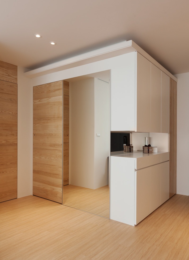Modern apartment design maximizes space minimizes distraction for Door in the wall