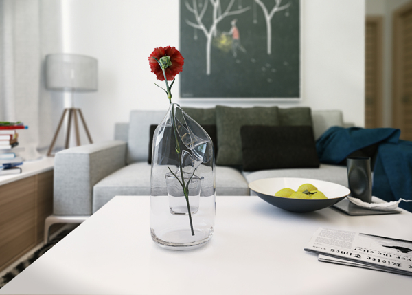 Sometimes its the little details that make or break a room's decor. Here a single red carnation and bowl of limes adds a lively element of color and nature to the otherwise neutral space.