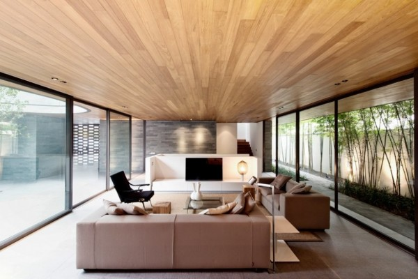 The light wood plank ceiling adds interest amongst the other neutral low-key elements of the main living room.