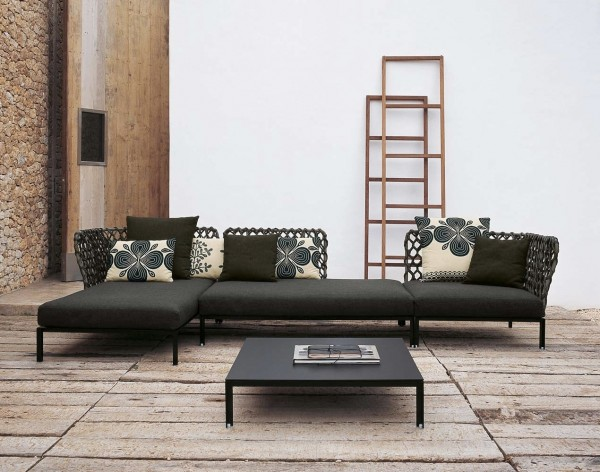 This woven-backed sofa is truly unique and is a conversation piece for any space. Relaxation is achieved with the use of accent pillows. The room itself has an earthy atmosphere and this piece brings modernity with a natural woven element.