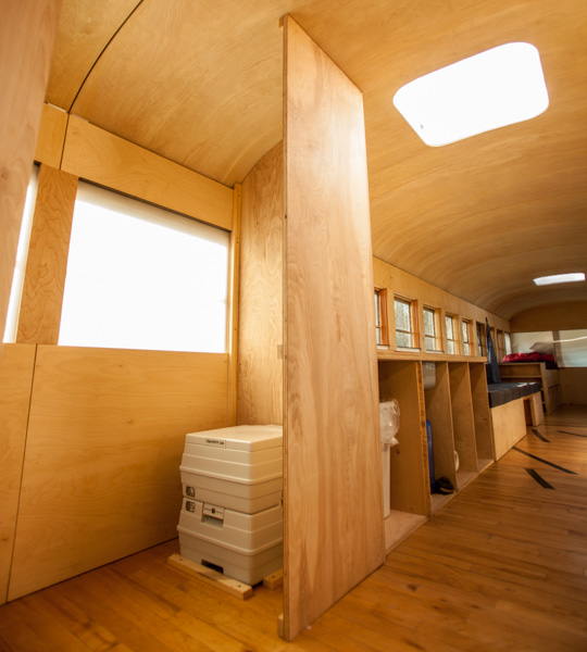 Bus Home Bathroom - School bus converted into small home by architecture student
