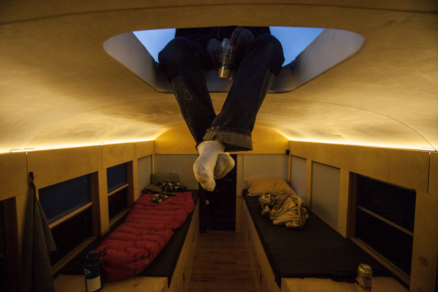 Bus Home Skylight - School bus converted into small home by architecture student