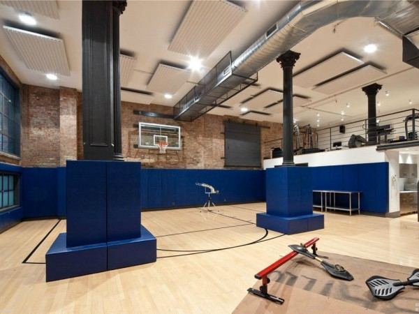 This lavish home also comes with a fitness center in the basement overlooking a basketball court.