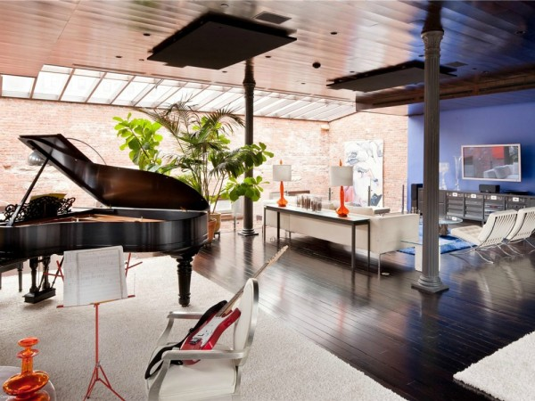 The sixth floor also has a music room hosting both classic and contemporary instruments. Another more casual living room area is also seen with yet another skylight.