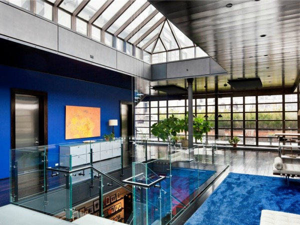 The sixth floor has patio access as well as a stairwell to the rooftop patio. It also has a skylight that brightens the entire space. The design here is bold with espresso wood floors and royal blue walls and carpeting.