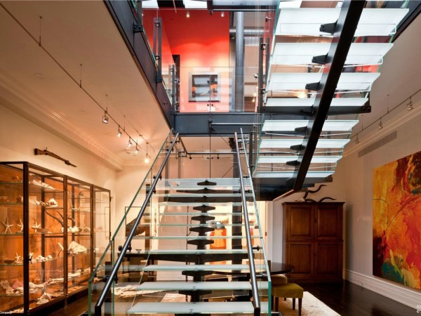 This impressive staircase can be seen on the top three floors that are considered the owner's triplex, as it continues here into an open gallery space.