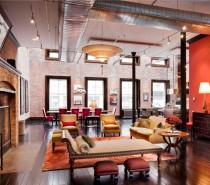 The grand fireplace is the focal point and the exposed ductwork keeps alive the fact that this building was once a shoe factory.