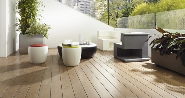 Contemporary designed furniture complete this outdoor patio with medium toned hardwood flooring.
