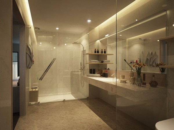 Although there isn't much privacy in this bathroom, there is style. A glass enclosed shower and toilet area really open up the room and make it appear very large.