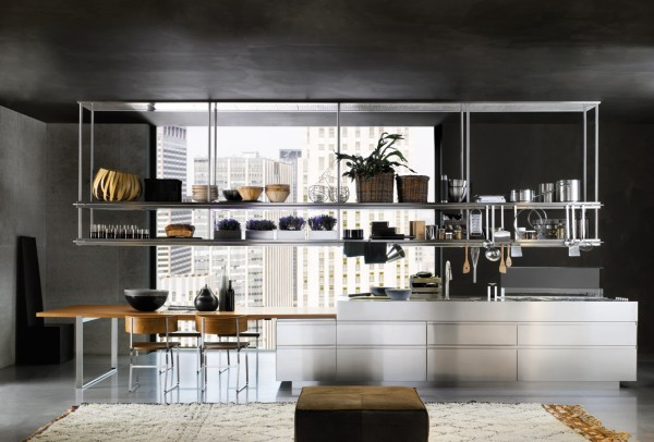 Very organized, functional kitchen using overhead stainless steel racks.