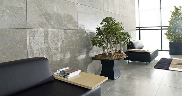 Natural stone wall tiles add a contemporary feel to this lobby space.