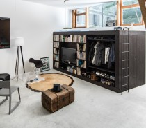 Though the cube offers a tremendous amount of storage space, its size does not overwhelm the Bern apartment. Instead, it acts as a focal point for visitors. Tucking it away in the corner also means it does not consume valuable floor space.